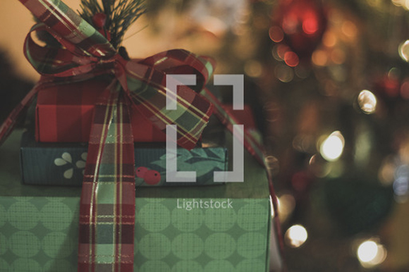lightstock-110569-wrapped-christmas-presents-under-a-christmas-tree